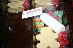 Great idea for a group gift - it's a kit, ready to go, for making cookies. Instead of gingerbread, these are sugar cookies. The kit is given in a floral corsage box and wrapped with a bow.