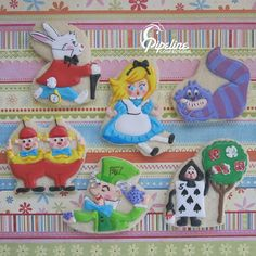 Alice In Wonderland Cookies        Collection by pipeline confections on Flickr - white rabbit, purple cheshire, blue dress, black playing card, green mad hatter, red tweedle