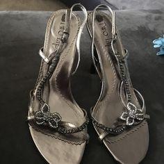 A bronze color heel w/ rhinestones A Bronze color heel w/ rhinestones the brand is by Two Lips Shoes Heels