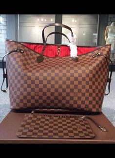 The inside is re-designed with red textile lining and legacy details inspired by LV archives. The red linings lend a pop of vivid color to the timeless Damier Ebene canvas. See elegant Damier Ebene bags at http://www.luxtime.su/louis-vuitton-handbags/damier-ebene