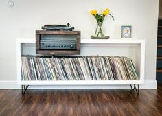 Check out tactilewoodshop.com This simple mid-century modern rustic style console is ideally sized for use as a vinyl record player + stereo stand and record storage cabinet. It can be mounted directly on a wall or fitted with mid century modern hairpin leg. It is available in two Record Player Cabinet, Modern Record Player, Record Player Console, Vinyl Record Player, Vinyl Records, Record Player Furniture, Vinyl Record Cabinet, Lp Player, Record Stand