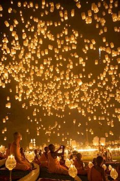 Floating lantern festival in Tailand, I hope to see this in person some day. so cool!