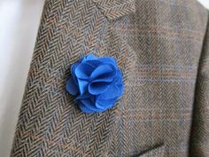 This charming Blue Linen boutonniere adds a perfect touch to any attire.