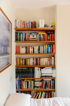 bookshelf in a bedroom nook
