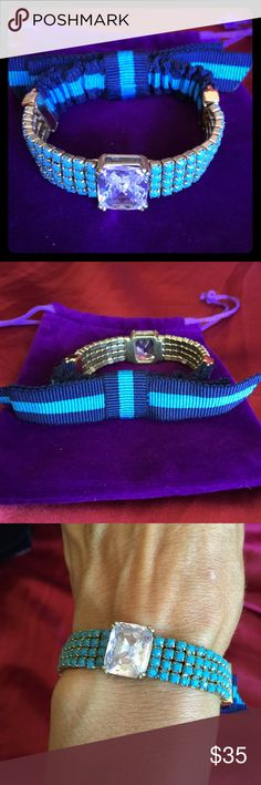 Juicy Couture stretch Bracelet Blue Bow & Stones Stretch bracelet, mixed media from Juicy Couture- new without tags.  Lots of little blue stones, a bow in blue and dark blue striped ribbon and of course a large jewel front and center.  Classic Juicy.  Stamped so you know it is authentic.  Purchased from Nordstrom sometime back but does not work with my horse-girl ranch style!  Needs a good home! bundle for discount, not taking offers at this time  Amy Juicy Couture Jewelry Bracelets