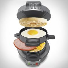 Another kitchen appliance I'll never use, but need!  Fancy - All In One Breakfast Sandwich Maker