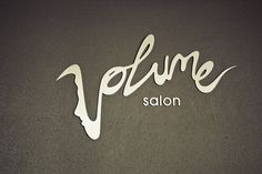 "This salon logo is awesome! I love how they made the word ""volume"" look musical and fun with a hidden face."