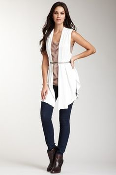 Drape vest and belt, skinny jeans and ankle booties.