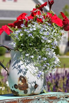 I love planting in old enamelware! http://bec4-beyondthepicketfence.blogspot.com/2014/07/a-little-blue-stool-or-table.html