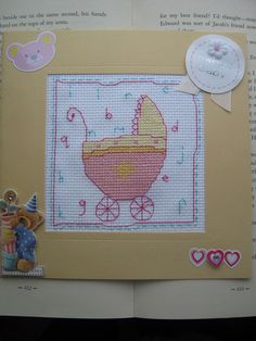 cross stitched baby girl card