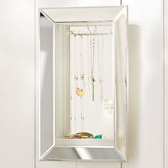 Mirrored Wall Jewelry Storage, Rectangle  This could be a fun way to display all of my jewelry