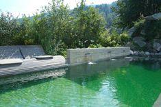 Schwimmteich, Naturpool Eine Sonnenliege lädt zum Entspannen am glasklarem Wasser ein. Die Natursteine direkt am Wasser geben dem Schwimmteich einen besonderen Rahmen. #Naturpool River, Outdoor Decor, Home Decor, Water Pond, Natural Stones, Swimming, Landscaping, Frame, Decoration Home