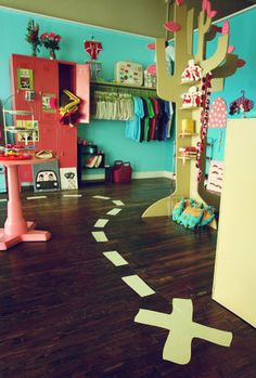 kids room.  Love the aqua wall.  Would work well with red and pink!