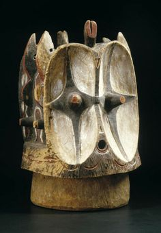 Africa | Janus helmet mask from the Bembe people of DR Congo | Wood and pigment || Known as Kalunga, this barrel-shaped mask of the Bembe is said to embody forest spirits, and was generally hidden away and revealed only to select initiates. Its appearance in the village could range from entertainment to the imposition of fines and the settling of disputes especially if a member of the Alunga association was concerned.