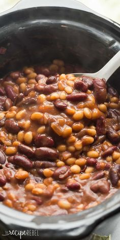 We LOVE these for summer barbecues! Healthier Slow Cooker Baked Beans that pack a big punch of flavor with maple syrup and balsamic vinegar -- great cold or warm! Gluten free. http://www.thereciperebel.com