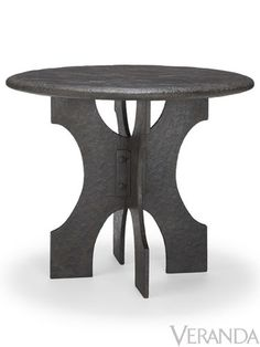 This Etruscan side table with cast-stone top and hammered-iron base is handsome and bold.