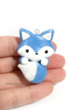 Adorable blue arctic fox handmade with polymer clay. Available as a charm, keychain, or necklace! Perfect gift for any fox lovers! #polymerclay #kawaii #bluefox #fox #handmade