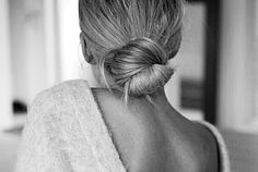 Polished Low Bun And A V-Back Sweater