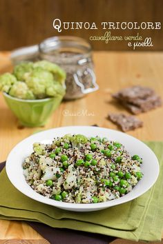 Quinoa tricolore con cavolfiore verde e piselli fini