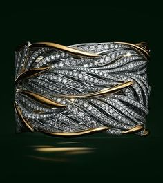 Flowing gold and platinum leaves twist around the wrist, accentuated with brilliant diamonds. #GoldandSilver