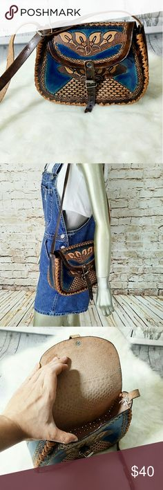 NWOT Handcarved tooled Cowboy style crossbody Tooled leather crossbody in blue-brown. Cute with jeans. Music Festival bag. Whipstitch details and adjustable length. Made of real leather. Bags