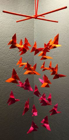 Its an origami butterfly mobile completely handmade. The butterflies are made of neon colors. Its covered with acrylic coating so you dont have to worry