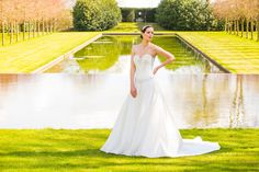 Style C17113, Satin and lace wedding dress with beaded sweetheart neckline.