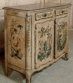 Fancy Antique furniture painted in the Chinoiserie style which was all the rage during the century in Europe this Antique Country French Buffet is a wonderful