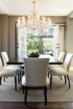 This dining room is simple and elegant, with a standout chandelier