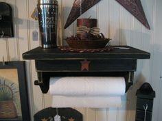 """Pretty Prim"" paper towel holder for a kitchen."