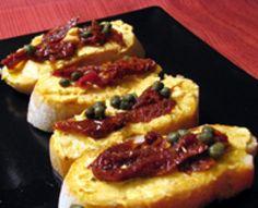 Goat Cheese with Paprika, Garlic, Sun-Dried Tomatoes and Capers Recipe: Goat Cheese with Paprika Tapa - Queso de Cabra con Pimenton