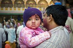 """""""The Toddler"""". When I was taking photos of the people celebrating Holi Festival, I noticed this toddler was looking at me for a while. Location: Mathura, India. (Photo and caption by Ng Hock How/National Geographic Traveler Photo Contest)"""
