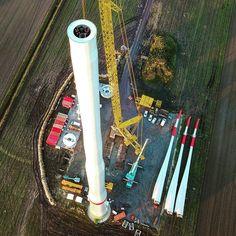 The newest Enercon wind turbine under construction.  #windpower #windkraft #energie #energy #windturbine #windmill #windenergy #wind #turbine #windfarm  #repowering #construction #crane #blades #tower #site #renewable #cleanenergy #dronestagram #drone #view #photo #green #climatechange