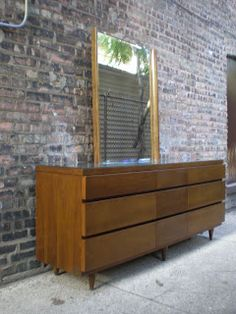 Bassett 9 Drawer Lowboy Dresser with Mirror and Glass Top...replace the ikea dresser that is falling apart....