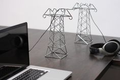 """Power Lines created by Daniel Ballou to give respect for your PC cables: """"There are hundreds of miles of power lines strung across the California desert landscape. A miniaturized version in bent, chromed wire works well for the desk."""" Profuct still in concept mode."""