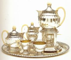 """Otto Prutscher, Tea and Coffee Services, c.1920     Click image for 700 x 595 size.Otto Prutscher, tea and coffee service, silver and ivory, Austrian, c.1920.  Scanned from """"Art Deco 1910-1939"""" edited by Charlotte Benton, Tim Benton and Chislaine Wood."""