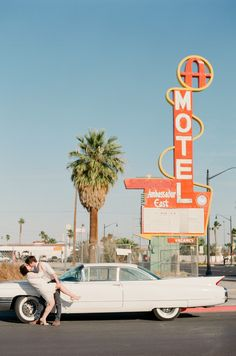 mid century vintage las vegas wedding/elopement with a classic cadillac & retro motel signs | Gaby J Photography
