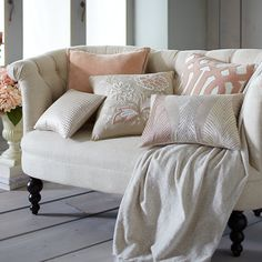 Subtle nod to spring: Dress up Pier 1's flirty Colette Loveseat with a few warm, inviting pillows and a comfy throw.