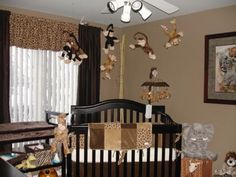 Jungle Safari Nursery: Our spare room already had some safari theme to it.  When we found out we were expecting we decided to keep the theme going, but added some stuff to make