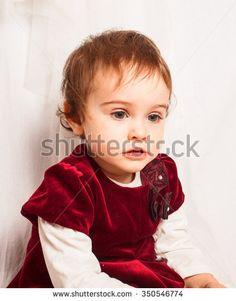 Waist of girl with elegant red velvet dress. - stock photo