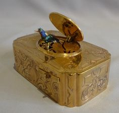stock number 4669   Antique singing bird box in gilt bronze with enamel lid signed John Manger and Son London.