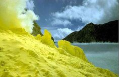 Largest acid lake in the world in Eastern Java, Indonesia. Yellow is Sulfur that is mined.