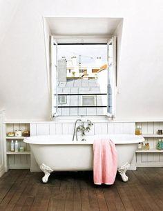 Bathtube and wooden floor