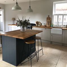 Create a two tone kitchen using a navy kitchen and cream kitchen. Pair with wooden worktops and natural elements to create a rustic kitchen. Add in a ceramic sink/Belfast sink to channel a traditional kitchen. Isn't this the perfect cottage kitchen? @1930s_doer_upper