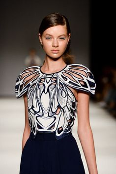Symmetrical Pattern Fashion - intricate lasercut detail; mirror symmetry; sculptural sleeves // Alice McCall