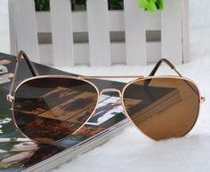 Óculos de Sol Aviador Medidas: 13 x 5 apróximados Óculos Material: resina Material da Armação: metal cor: Armação dourada e lente Marrom UV 400 http://i.imgur.com/Ue7YArj.jpg http://i.imgur.com/4I3hA3t.jpg