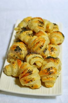 Italian Food - Cornetti alle acciughe, mozzarella e semi di papavero. (Croissants with anchovies, mozzarella cheese and poppy seeds)