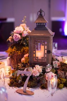 Megan Galloway and Shaun Rowan's Romantic DFW Wedding at Piazza in the Village. Lantern centerpiece for an enchanted forest wedding. Pink florals and moss with silver table number. Moss Centerpieces, Sweet 16 Centerpieces, Sweet 16 Decorations, Quinceanera Centerpieces, Quinceanera Party, Centerpiece Ideas, Enchanted Forest Centerpieces, Enchanted Forest Party, Whimsical Wedding Theme