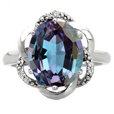 Gemologica Bold Oval Cut Alexandrite Gemstone Diamond White Gold Ring by Gemologica - An alexandrite gemstone, in a bold setting, is the centerpiece of this ring. The ring contains a cre Hyderabad, Custom Jewelry, Vintage Jewelry, Small Rings, White Gold Rings, Black Gold, Jewelry Stores, Sterling Silver Jewelry, Jewelry Rings