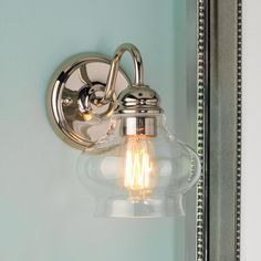 Clear Cloche Glass Sconce Clearly stylish with a shapely onion glass globe and polished nickel or bronze hardware for a look that goes traditional to modern!